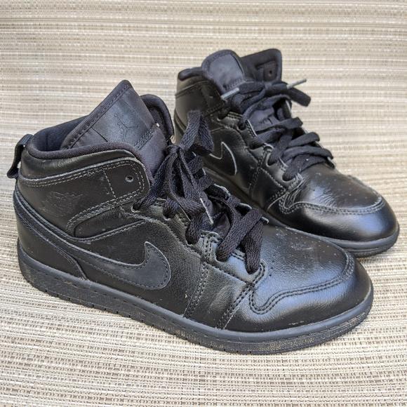 solid black air jordans
